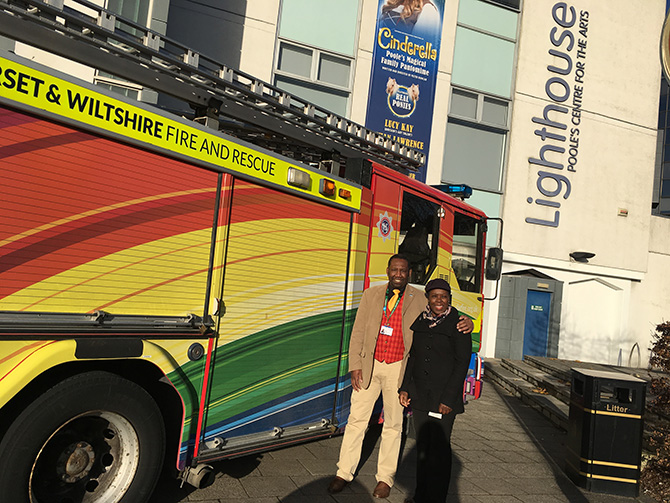 Dorset HealthCare Equality and Diversity Manager Dave Corbin and Claudette Brady from the Trust's Black, Asian and Minority Ethnic (BAME) Staff Network showing their support for the new NHS LGBT Network, in front of the Rainbow Fire Tender loaned by Dorset & Wiltshire Fire and Rescue Service
